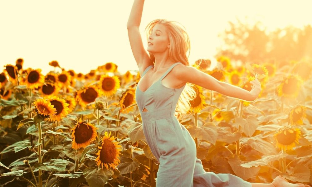 girl-dancing-sunflower-field-keystones-good-health