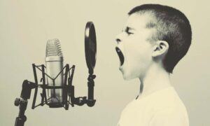 boy-shouting-into-microphone-elevator-pitch