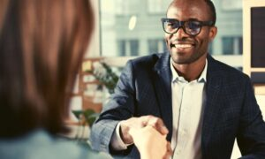 man-and-woman-handshake-informational-interview