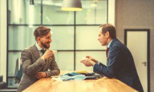 men-meeting-over-coffee-informational-interview