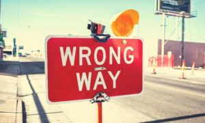 wrong-way-sign-following-through-with-action